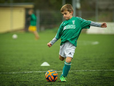 boy playing football. sports club lottery